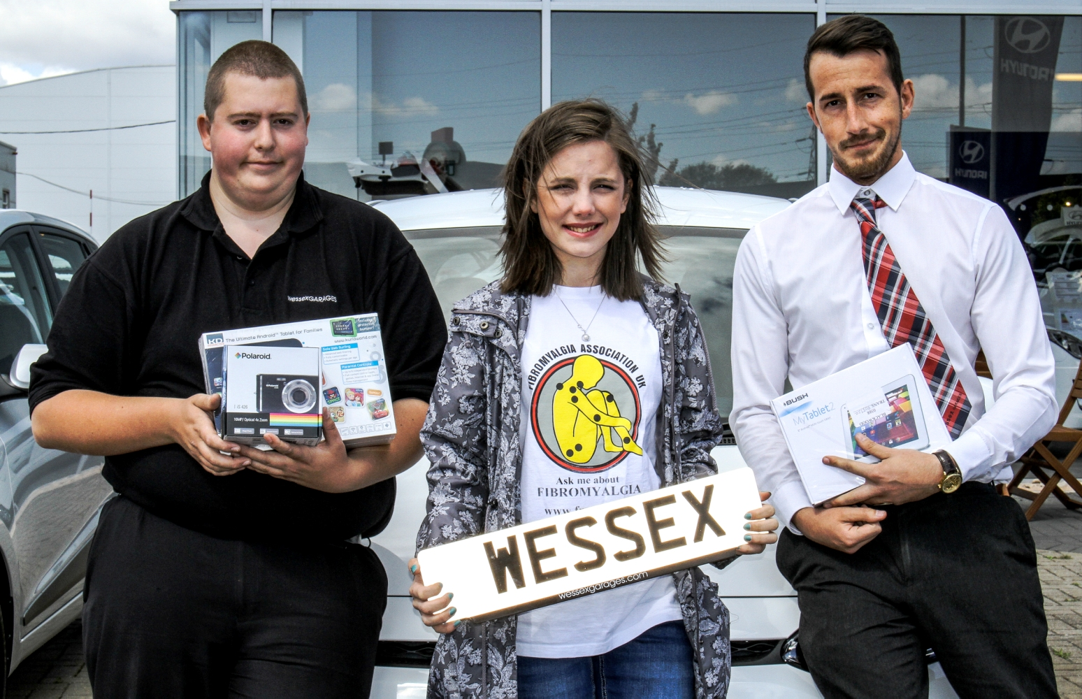 (From left to right) Richard Renshaw, Digital Sales Executive, Bethan Williamson and Jamie Thomas, Hyundai Salesman, with the prizes Wessex Garages won in the auction.