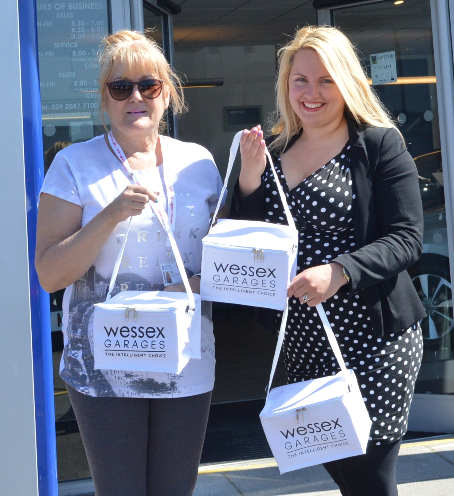 (From left to right) Linda Davies, Senior Fundraising Officer at Noah's Ark Children's Hospital Charity and Ugne Briedyte, Digital Sales Executive at Wessex Garages, with some of the cool bags.