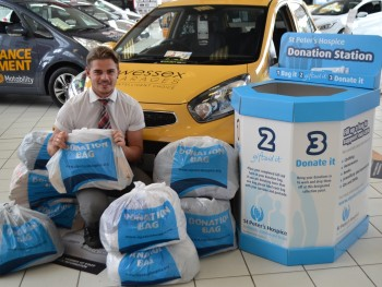 Staff collect bags of unwanted clothes in aid of charity