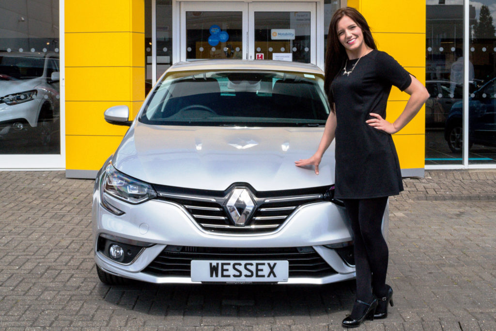 Cara Lee, Renault Salesperson at Wessex Garages, with the all-new Renault Mégane.