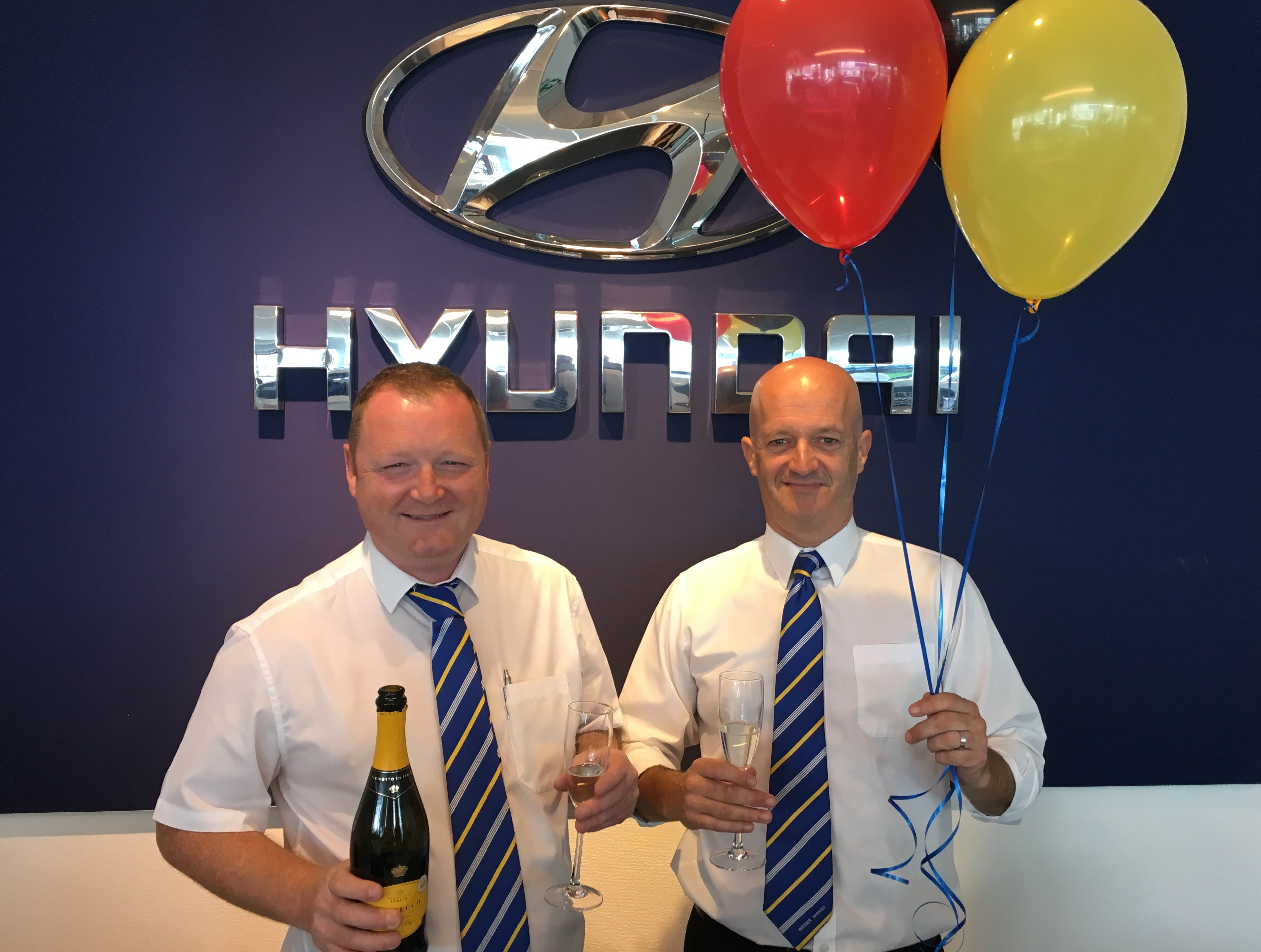 (From left to right) Wessex Garages' Hyundai Brand Manager, Mark Goodwin, and Sales Executive, Jake Ruckley, get ready for the Hyundai fifth birthday celebrations.