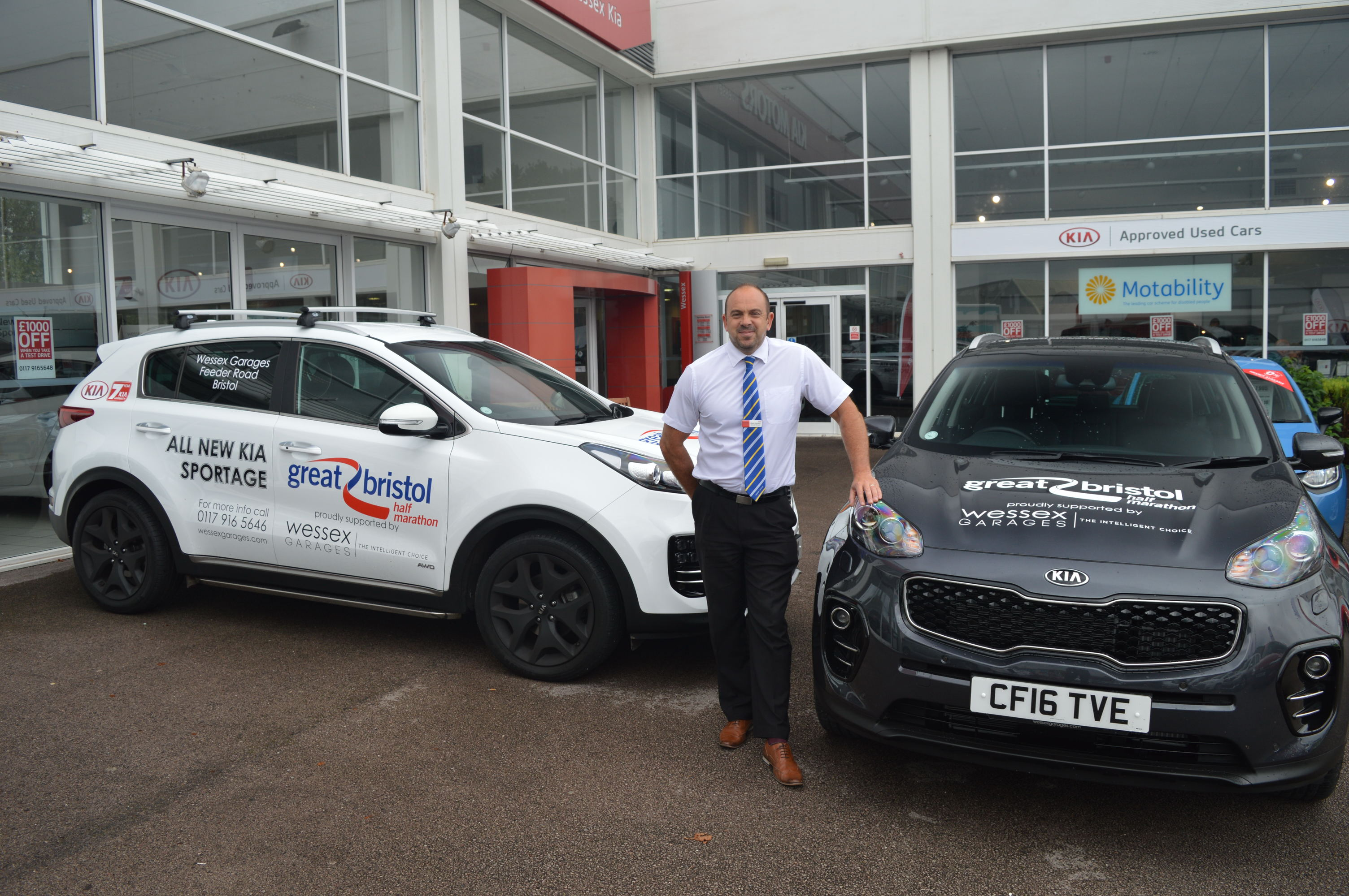 Mark Hayward, General Manager of Wessex Garages, with some of the four-wheeled support the dealership is giving the Great Bristol Half Marathon this Sunday, September 25.