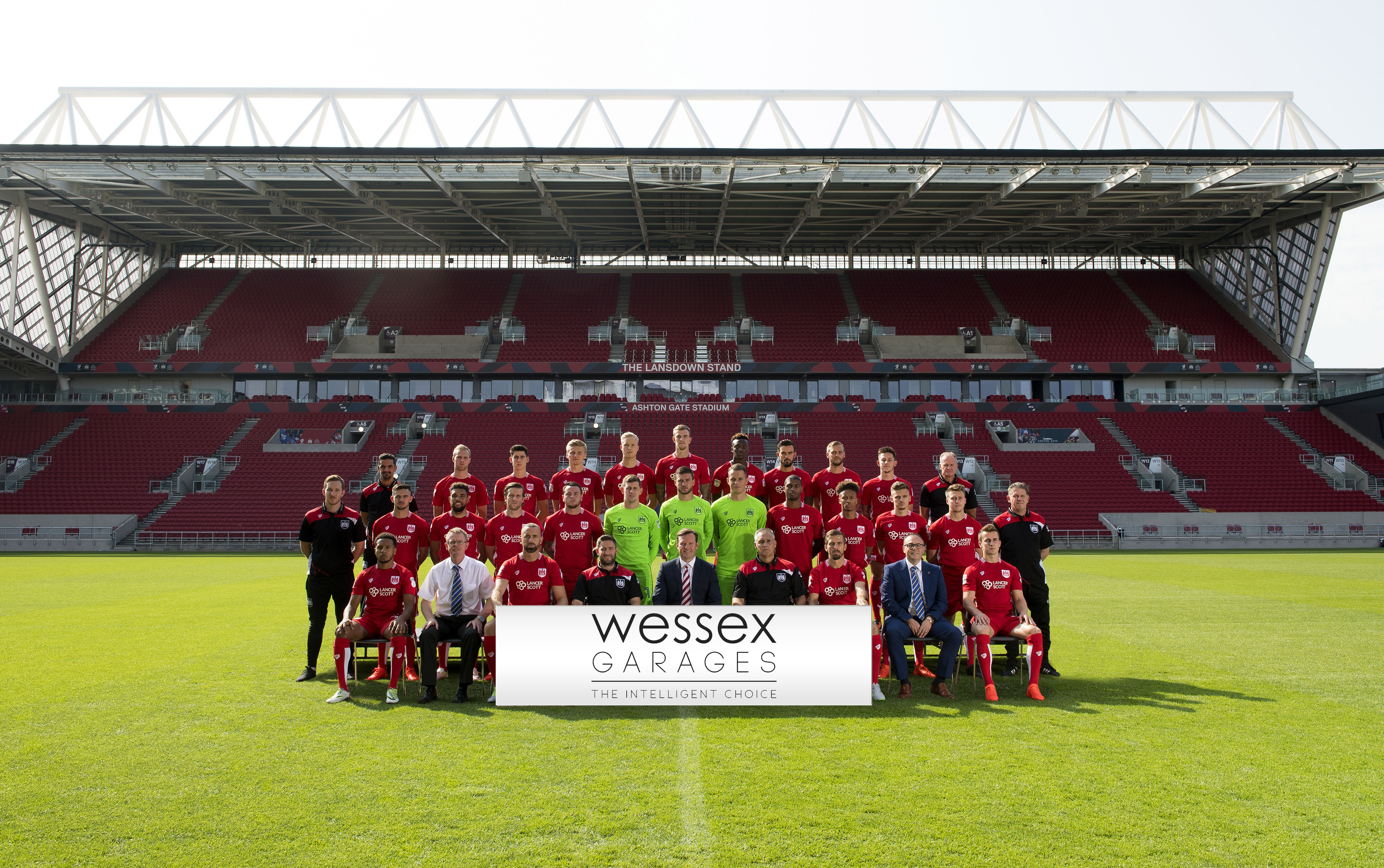 Bristol City have a team photo with Wessex Garages staff Keith Brock and Andy Provis