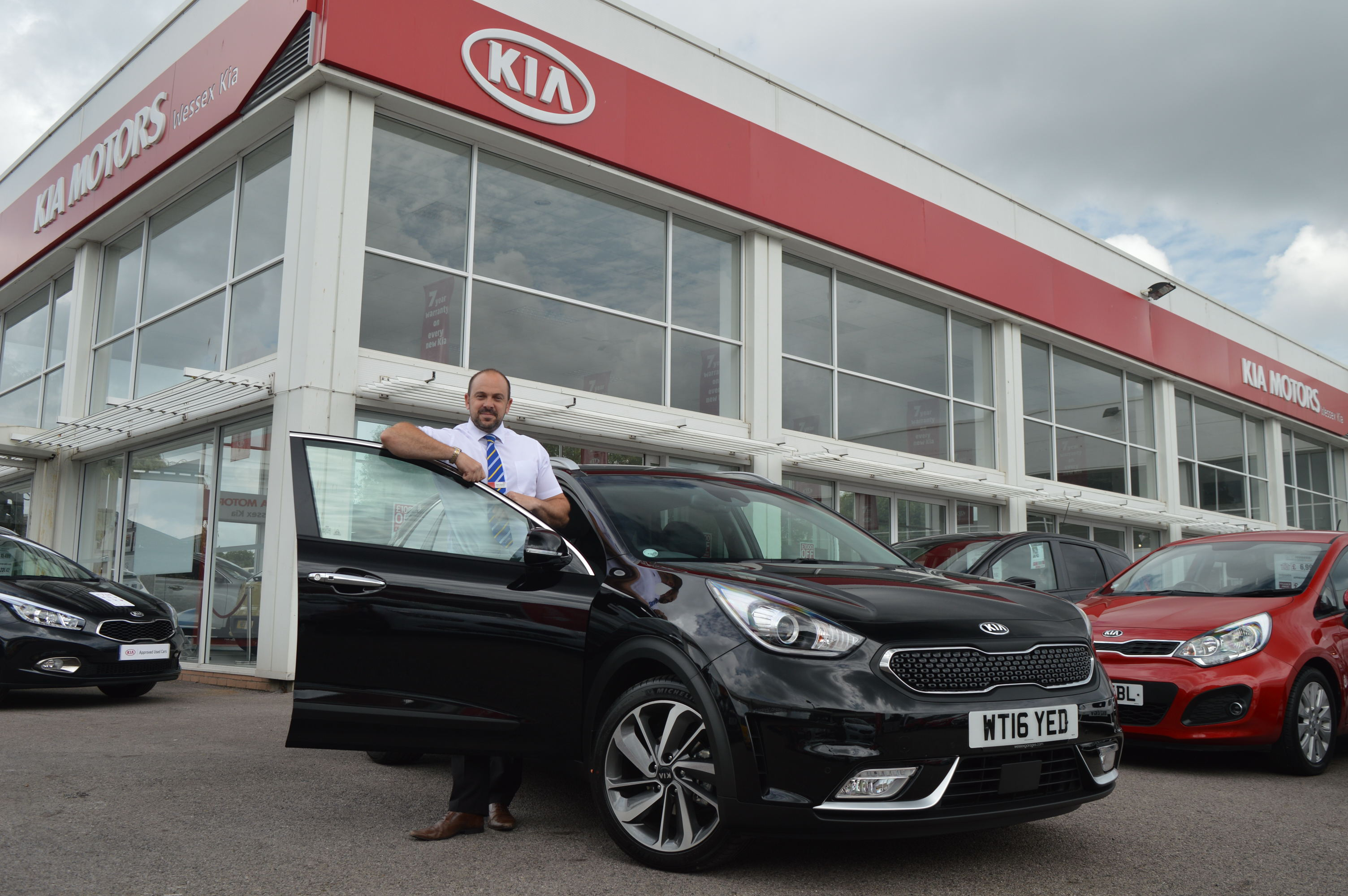 Wessex Garages' General Manager, Mark Hayward with the Kia Niro at the Feeder Road dealership in Bristol.